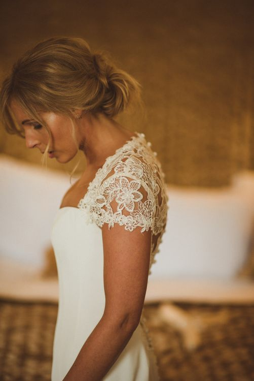 Bride in Lace Cap Sleeves Sassi Holford Bridal Gown