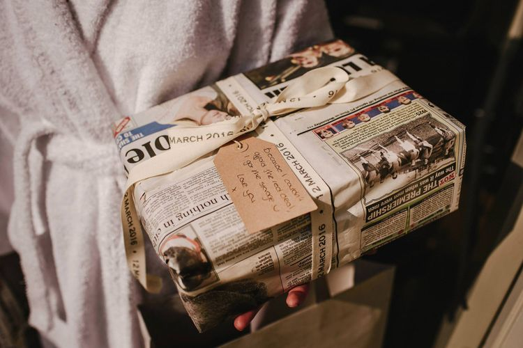 Wedding Present Wrapped in Newspaper | Andy Gaines Photography | Thompson Granger Films