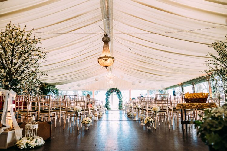Ceremony Room at Tinakilly Country house with Trees and Floral Arch