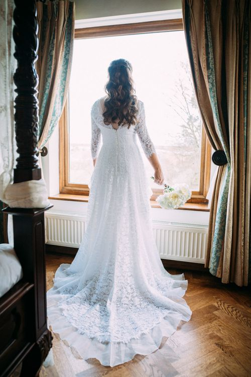 Bride in Lace Wedding Dress with Long Sleeves