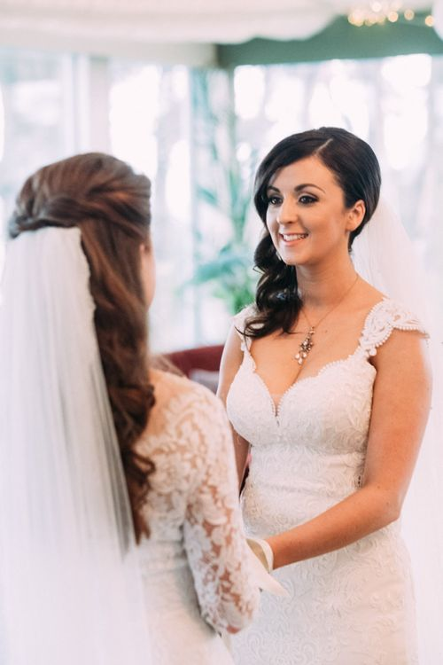 Two Brides in Lace Wedding Dresses Exchanging Vows at Wedding Ceremony