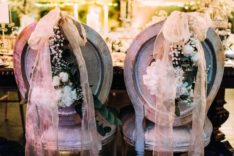 Chairs with Ribbon and Flower Decor
