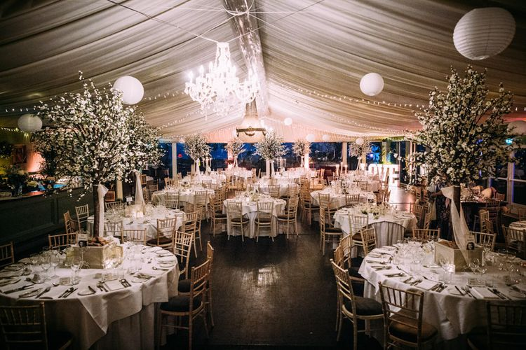 Wedding Reception Decor with Tree Centrepieces and Light Up Letters