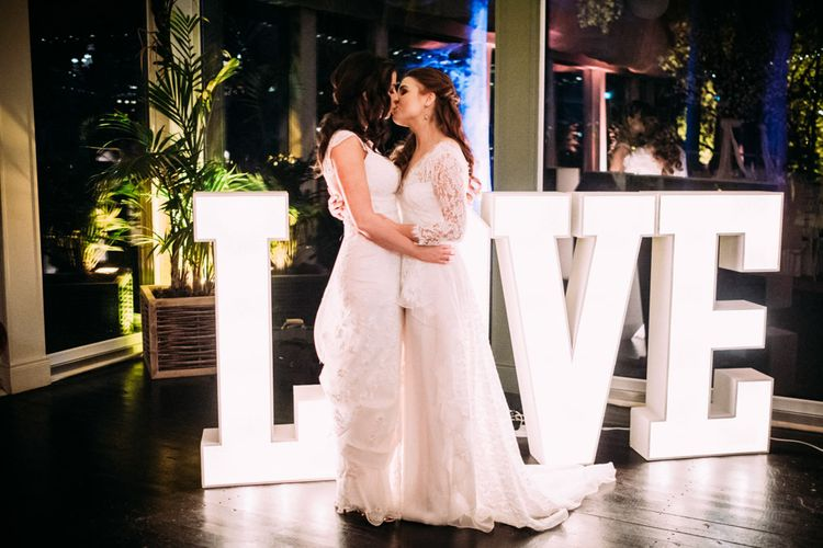 First Dance with Two Brides in Lace Wedding Dresses