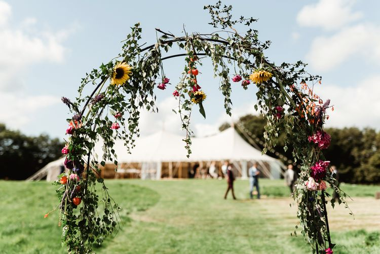 Wild Flower Arch | Colourful Outdoor Ceremony and Marquee Reception at Braisty Estate in North Yorkshire | The Lou's Photography