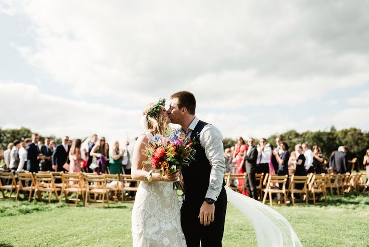Outdoor Wedding Ceremony | Bride in Claire Pettibone Gown | Groom in Waistcoat | Colourful Outdoor Ceremony and Marquee Reception at Braisty Estate in North Yorkshire | The Lou's Photography