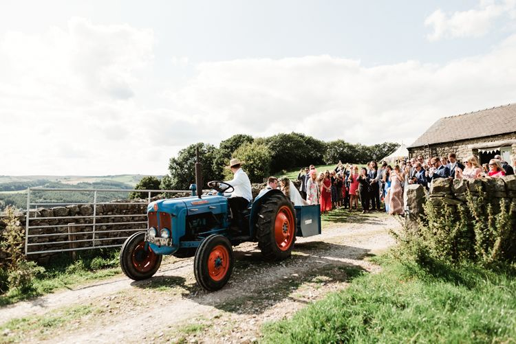 Tractor Wedding Transport | Bride in Claire Pettibone Wedding Dress | Groom in Waistcoat | Colourful Outdoor Ceremony and Marquee Reception at Braisty Estate in North Yorkshire | The Lou's Photography