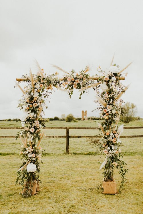 Wooden Frame Covered in Flowers, Foliage and Pampas Grass