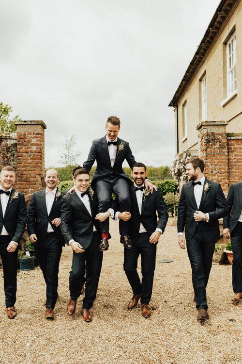Groomsmen in Black Tie Suits and Bow Ties