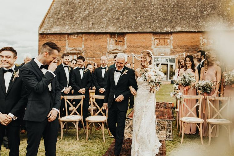Outdoor Wedding Ceremony at Godwick Barn with Bride in Boho Rue de Seine Wedding Dress and Groom in Tuxedo