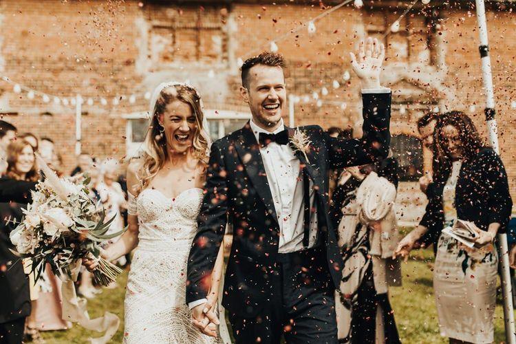 Confetti Exit with Boho Bride in Rue De Seine Wedding Dress and Groom in Black Tie Suit