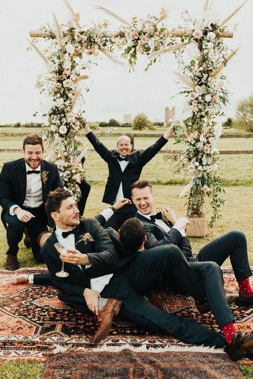 Groomsmen Having Fun in Their Black Tie Suits