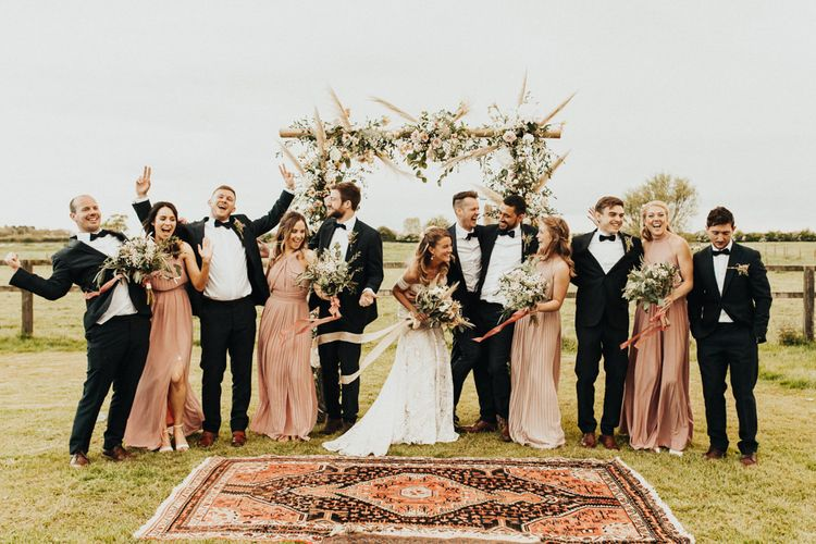 Wedding Party Portrait with Groomsmen in Tuxedos, Bride in Rue de Seine Wedding Dress and Bridesmaids in Pink ASOS Dresses
