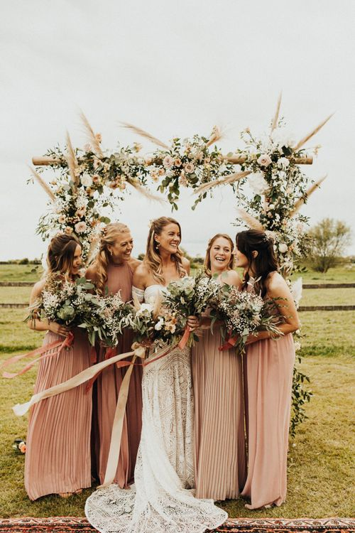 Bridal Party Portrait with Bride in Rue De Seine Wedding Dress and Bridesmaids in Pink ASOS Dresses