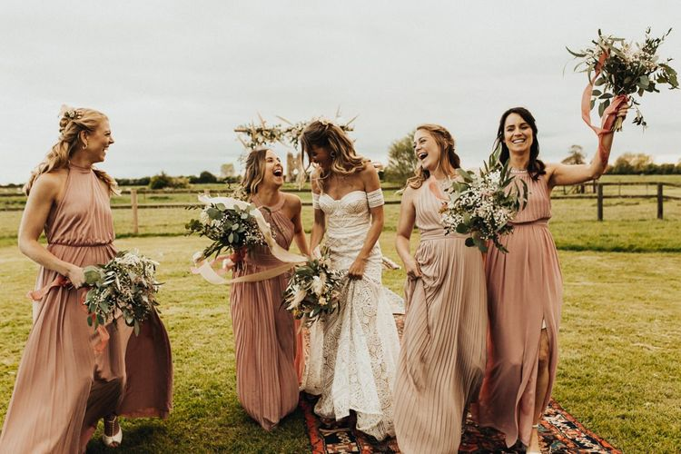 Bridal Party Portrait with Bride in Rue De Seine Wedding Dress and Bridesmaids in Pink Dresses