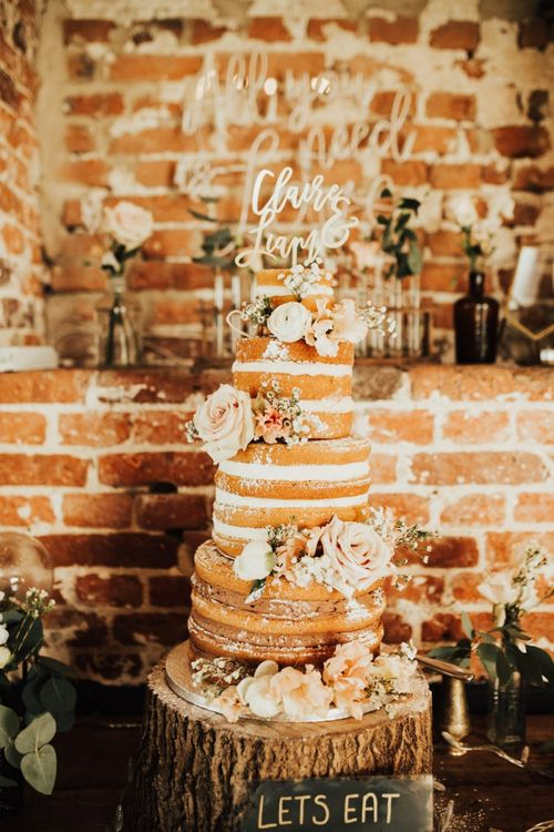 Naked Wedding Cake with Lasercut Cake Topper on Wooden Tree Slice Cake Stand