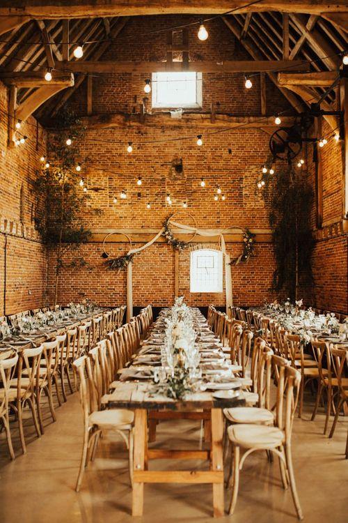 Godwick Barn Norfolk Wedding Reception with Festoon Lights, Drapes and Hoop Wedding Decor