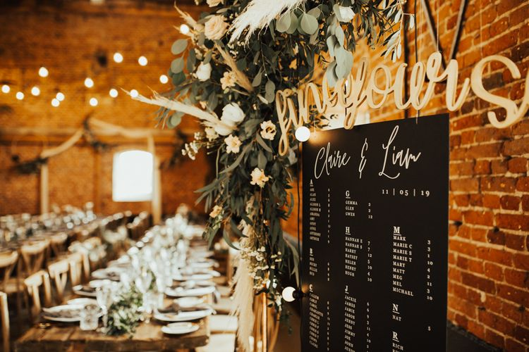 Hanging Seating Chart in Rustic Barn Reception