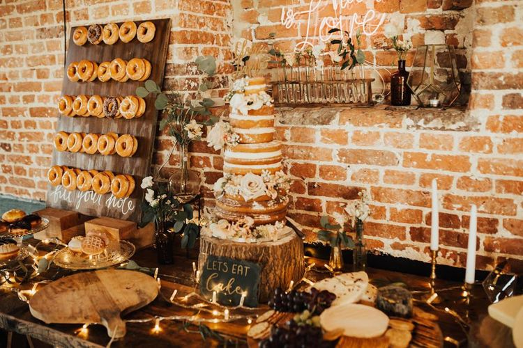 Dessert Table with Naked Wedding Cake and Doughnut Wall