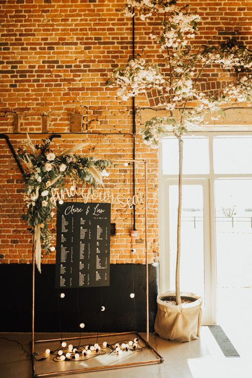 Copper Frame Find Your Seat Table Plan with Foliage and Pampas Grass Flower Arrangement