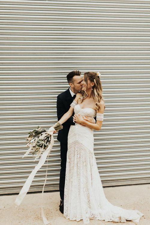 Groom in Black Suit Embracing a Bride in Rue de Seine Wedding Dress