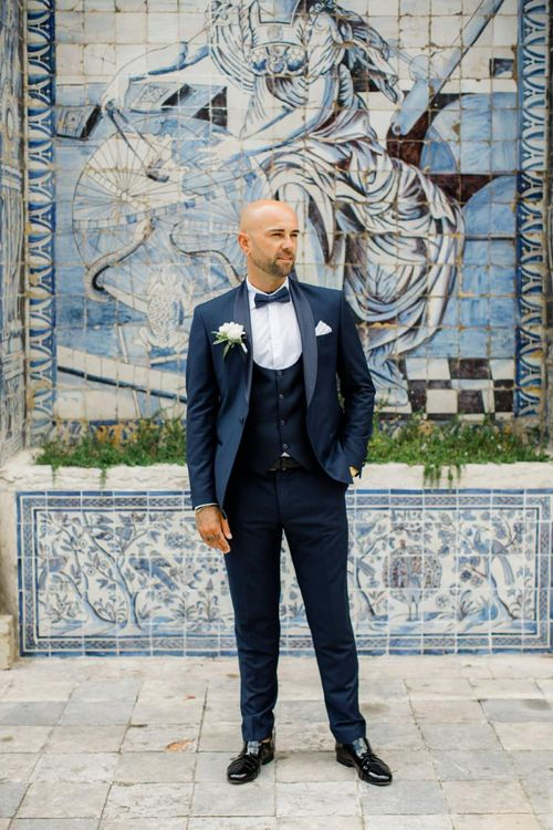 Groom in Navy Tuxedo with Horseshoe Waistcoat