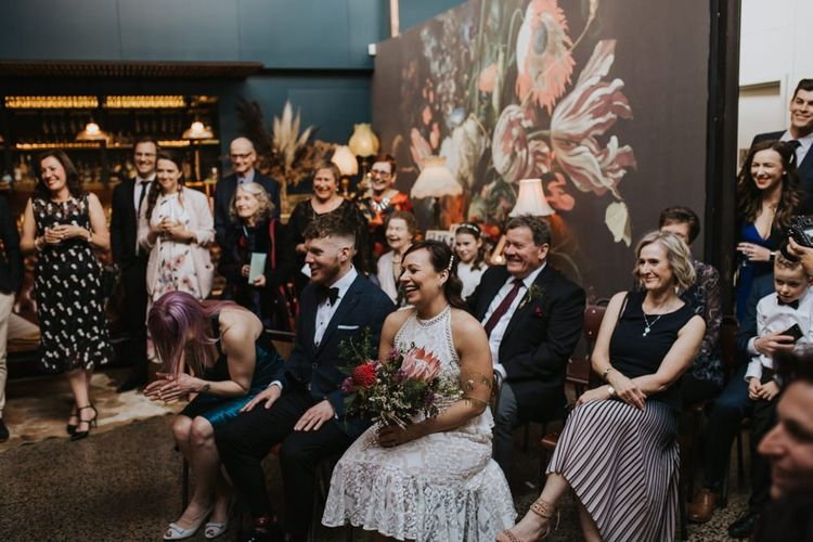 Guests watch ceremony at Australian wedding