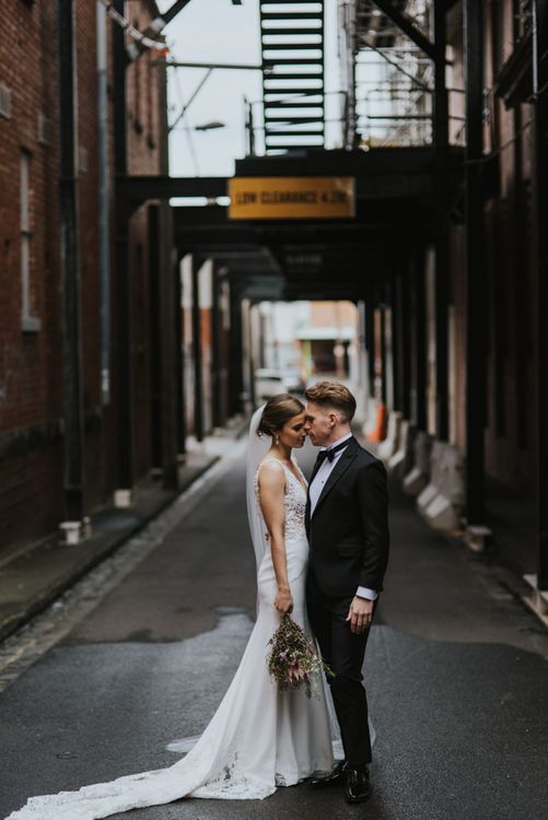 Bride and groom at monochrome industrial wedding