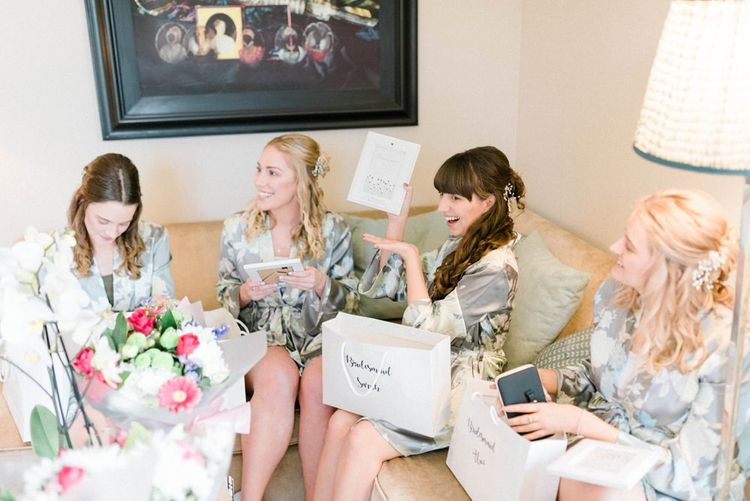 Bridesmaids opening presents at March wedding