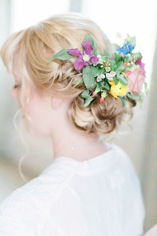 Bridal undo with floral hairpiece for March wedding