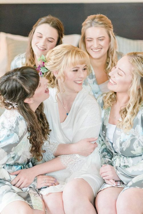 Bride with bridesmaids in getting ready robes