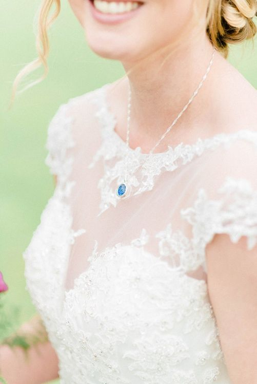 Lace wedding dress with personal necklace