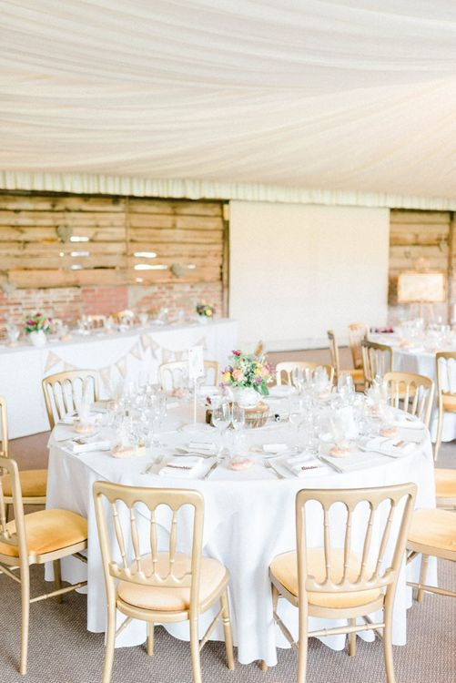 Wedding breakfast tables with rustic centrepieces at March wedding