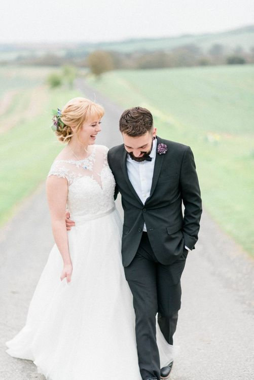 Groom in classic black tuxedo for March wedding