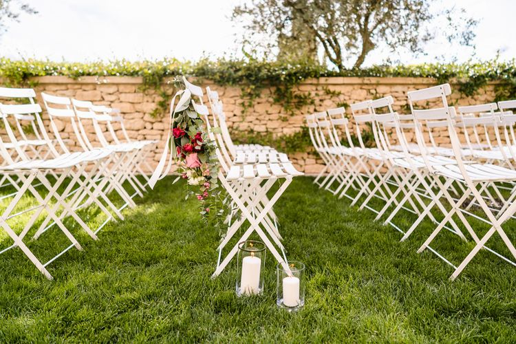 Aisle Chair Flowers | Outdoor Wedding Ceremony | Luxe Pink & White Destination Wedding at La Bastide de Gordes in Provence, France, Styled by Haute Wedding | John Barwood Photography | Motion Craft Creative