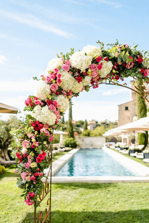 Floral Arch Wedding Flowers | Outdoor Wedding Ceremony | Luxe Pink & White Destination Wedding at La Bastide de Gordes in Provence, France, Styled by Haute Wedding | John Barwood Photography | Motion Craft Creative