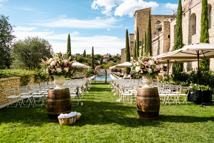 Outdoor Wedding Ceremony Decor | Barrels | Floral Arch | Luxe Pink & White Destination Wedding at La Bastide de Gordes in Provence, France, Styled by Haute Wedding | John Barwood Photography | Motion Craft Creative