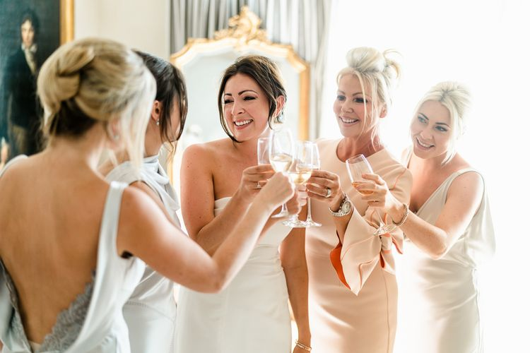 Wedding Morning Bridal Preparations | Bride in Carolina Herrera  Gown | Bridesmaids in Amanda Wakeley Dresses | Luxe Pink & White Destination Wedding at La Bastide de Gordes in Provence, France, Styled by Haute Wedding | John Barwood Photography | Motion Craft Creative