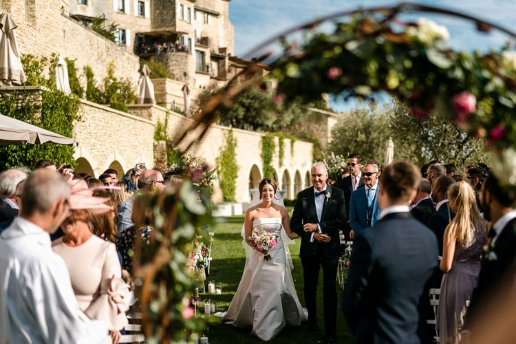 Outdoor Wedding Ceremony | Bridal Entrance in  Carolina Herrera Gown | Luxe Pink & White Destination Wedding at La Bastide de Gordes in Provence, France, Styled by Haute Wedding | John Barwood Photography | Motion Craft Creative