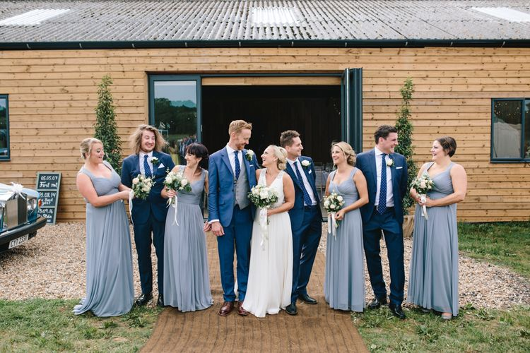 Wedding Party In Cornflower Blue Dresses // Embellished Jenny Packham Dress For Elegant Chafford Park Wedding With White Linen And Foliage Details Images From Parkershots