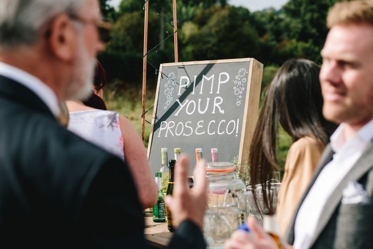 Pimp Your Prosecco Bar For Wedding // Embellished Jenny Packham Dress For Elegant Chafford Park Wedding With White Linen And Foliage Details Images From Parkershots