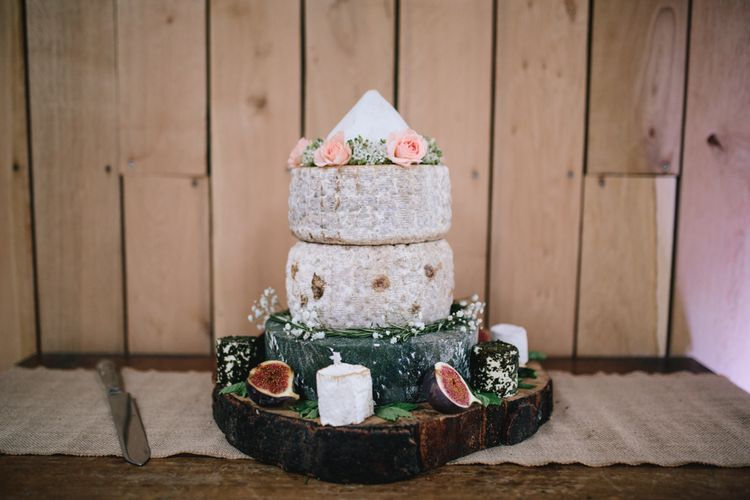 Cheese Tower For Wedding // Embellished Jenny Packham Dress For Elegant Chafford Park Wedding With White Linen And Foliage Details Images From Parkershots