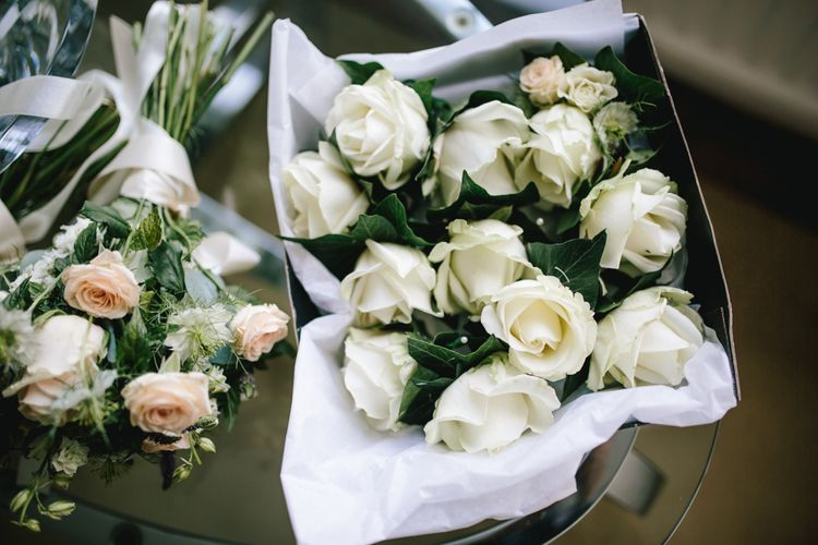 White Roses For Wedding // Embellished Jenny Packham Dress For Elegant Chafford Park Wedding With White Linen And Foliage Details Images From Parkershots
