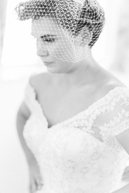 Wedding Morning Bridal Preparations with Bride in Lace Tea Length Wedding Dress with Birdcage Veil