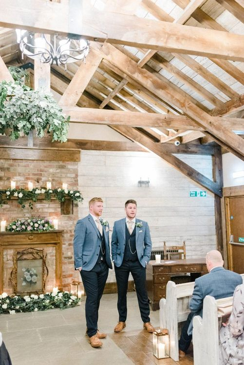 Groom and Best Man Standing at the Altar in Blue Moss Bros. Suits