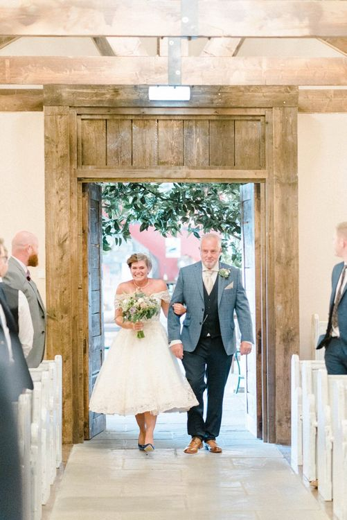 Wedding Ceremony Bridal Entrance with Bride in Lace Tea Length Wedding Dress and Birdcage Veil