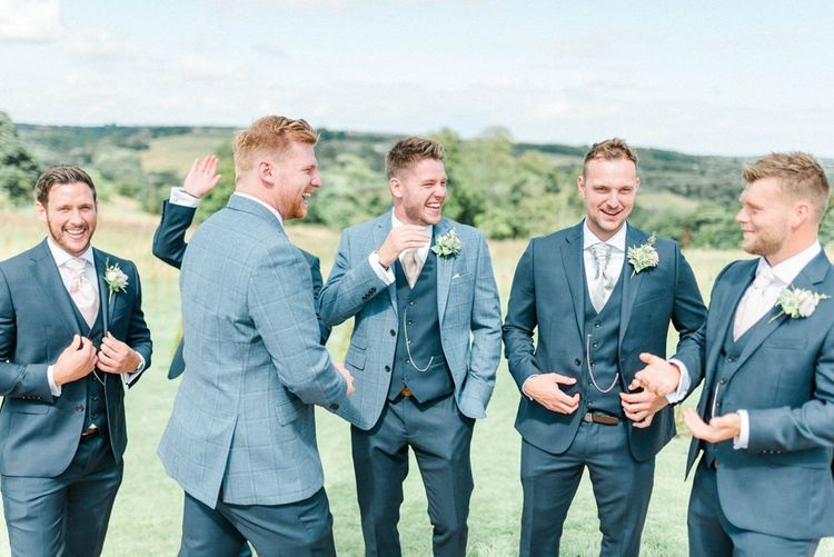 Groomsmen in Navy Trousers and Blue Blazer Wedding Suits from Moss Bros.