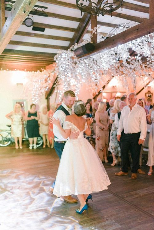 First Dance with Bride in Bride in Tea Length Wedding Dress, Birdcage Veil and Blue Manolo Blahnik Hangisi Shoes and Groom in Moss Bros. Suit