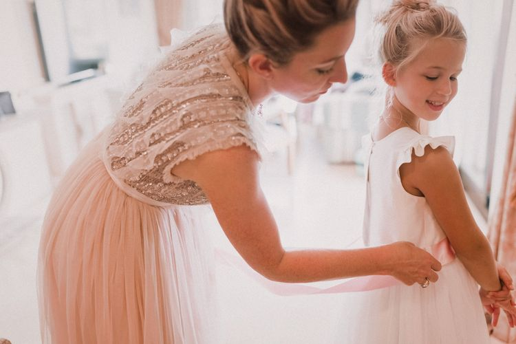 Flower Girl and Bridesmaid Getting Ready | Blush Pink & White Marbella Beach Wedding at El Chiringuito, Puente Romano |  Kino Ortega Photographer