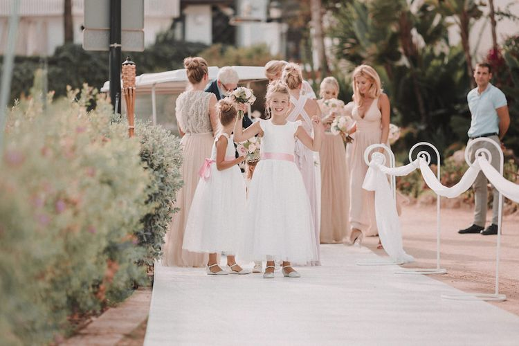 Bridal Party Entrance | Blush Pink & White Marbella Beach Wedding at El Chiringuito, Puente Romano |  Kino Ortega Photographer